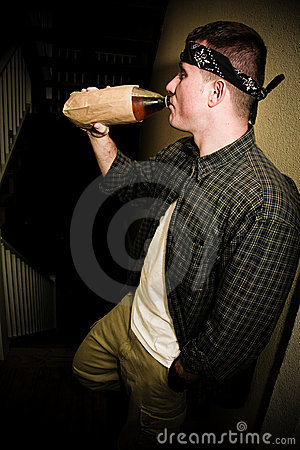 Man Drinking Alcohol in Urban Setting