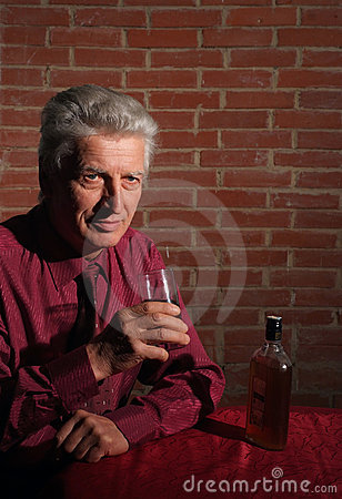 Man drinking on a black