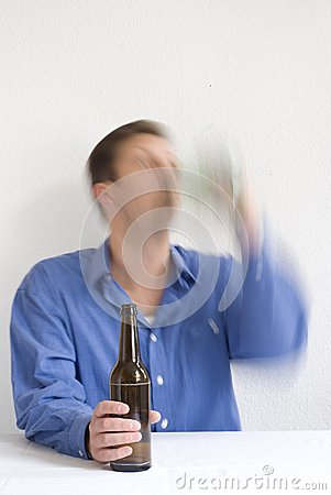Man drinking with both hands