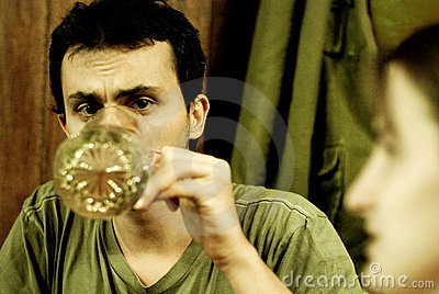 Man drinking from large mug