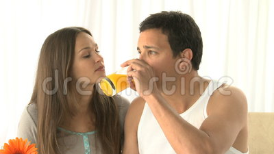 Man drinking orange juice with his wife at breakfast Stock Photo