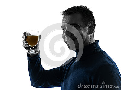 Man drinking orange juice silhouette portrait