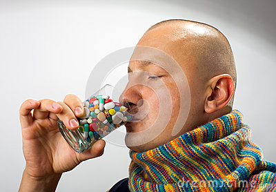Man drinking pills