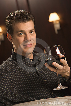 Man drinking red wine.
