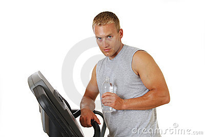 Man drinking water on a treadmill
