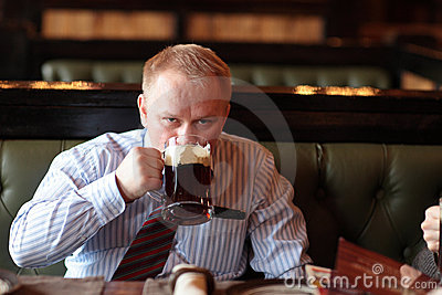 Man drinks brown ale