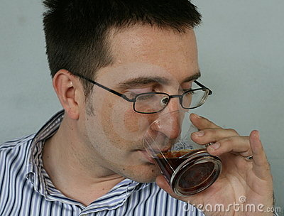 Man Drinks Swig Of Brandy
