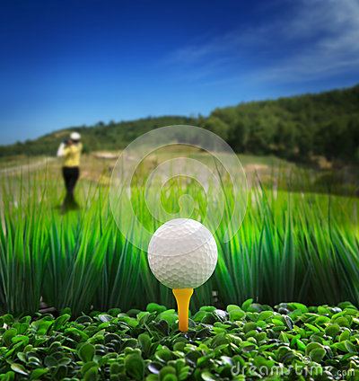 Man driving golf and close up of golf ball on gree