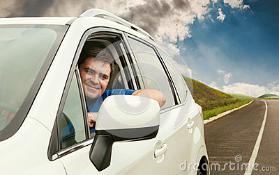 Man driving his car on the lonely road