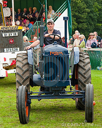 Man driving old Tractor Editorial Stock Image