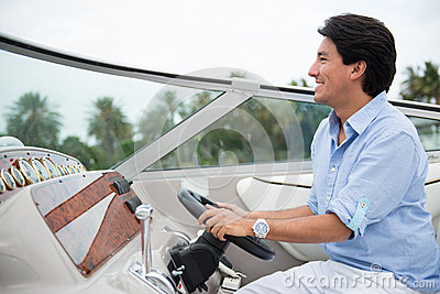 Man driving a yacht
