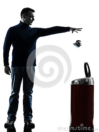 Man dropping a paper in a trash bin silhouette