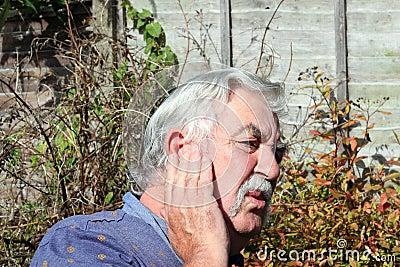Man with an earache.
