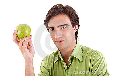 Man eating a green apple