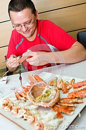 Man eating King crab