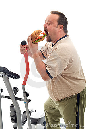 Man eating a large hamburger
