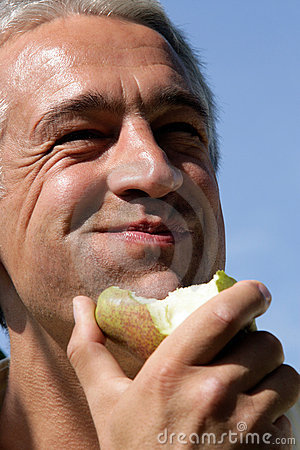 Free Man Eating Pear Stock Photography - 11242592