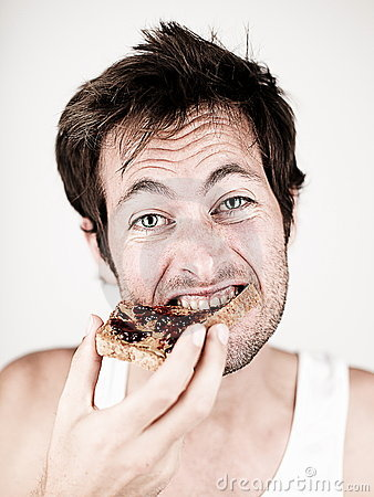 Free Man Eating Toast With Peanut Butter And Jelly Royalty Free Stock Image - 15394436