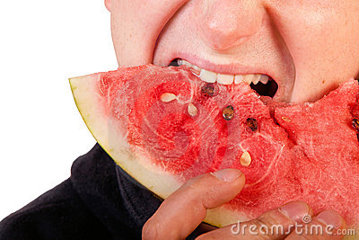 Man eating  watermelon slice
