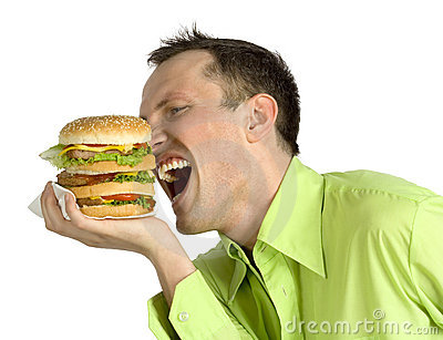 Man eats hamburger