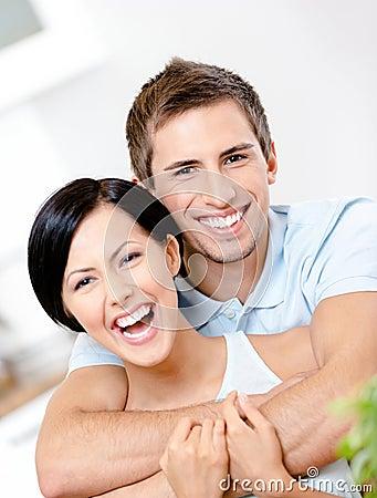 Man embraces his girlfriend