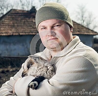 Man embracing a goatling.