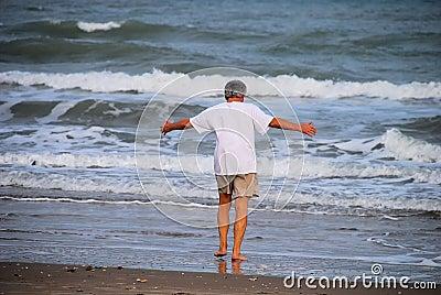 Man embracing the sea