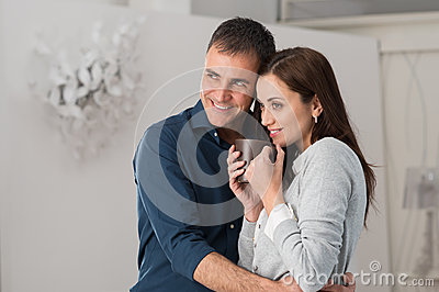 Man Embracing Woman Front Of The Window