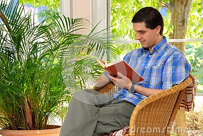 Man enjoying a book at home