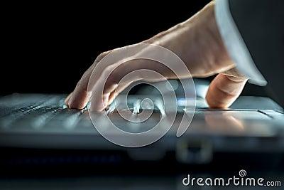 Man entering data on his laptop computer