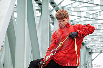 Man with equipment rope bridge