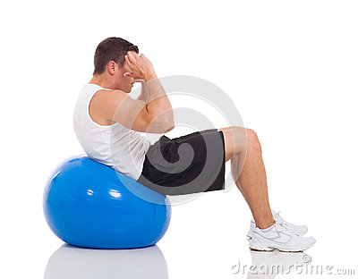 Man exercises gym ball