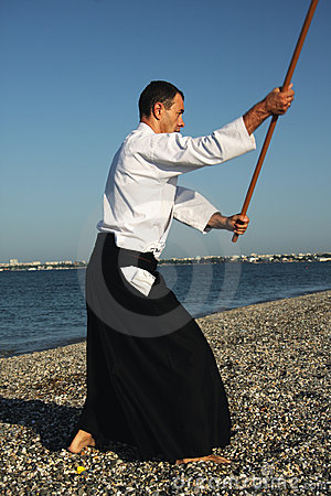 Man exercising aikido