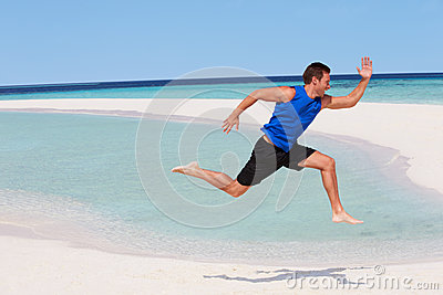 Man Exercising On Beautiful Beach