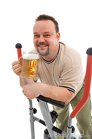Man exercising with a beer