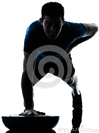 Man exercising bosu push ups fitness posture