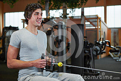 Man exercising on cable machine