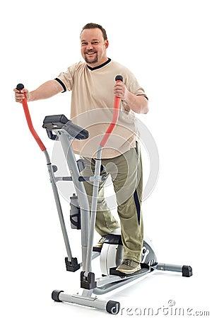 Man exercising on elliptical trainer