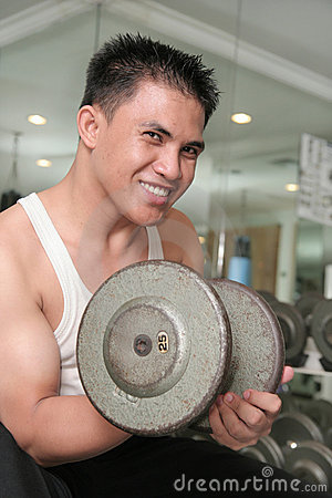 Man exercising smiling