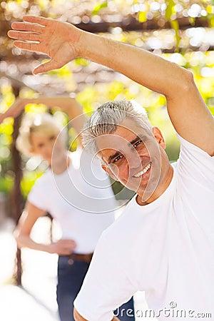 Man exercising wife