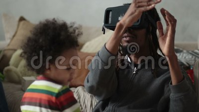 Man experiencing virtual reality with VR headset stock video