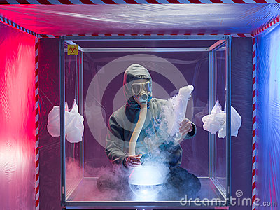 Man experimenting inside protection enclosure