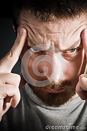 Man expressing headache or stress concept