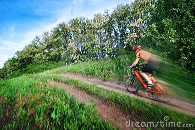 Man extreme biking blurred