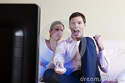 Man exulting watching tv
