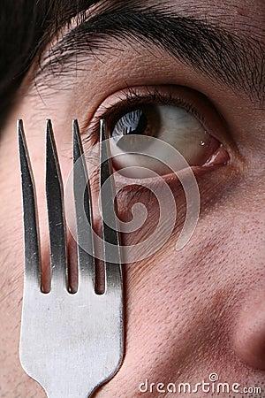 Man eye and fork