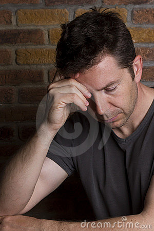 Man with Eyes Closed Rests on Arm