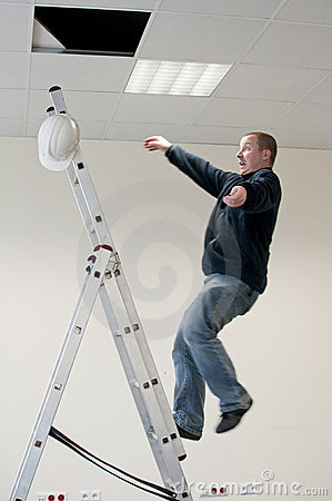 Free Man Falls From Ladder Royalty Free Stock Photography - 21875097