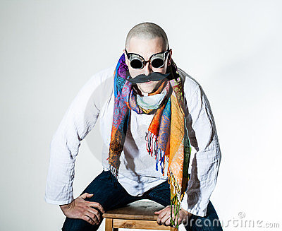 Man with false moustache and colored scarf