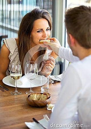 Free Man Feeding Bread To His Girlfriend Stock Photography - 24653302